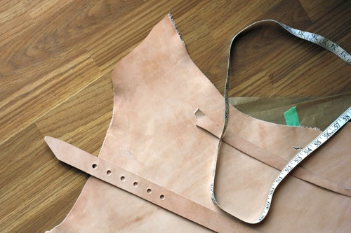 Detail shot of a veg tan hide and belt cut/punched ready for dying @ the atelier.