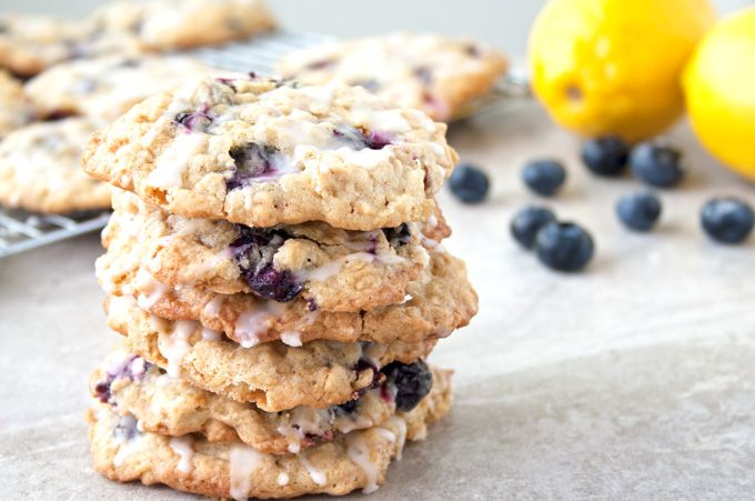 Blueberry Oatmeal Cookies with a Lemon Glaze - oatmeal cookies full of fresh blueberries and glazed with the bright citrus flavor of lemon. Delicious!