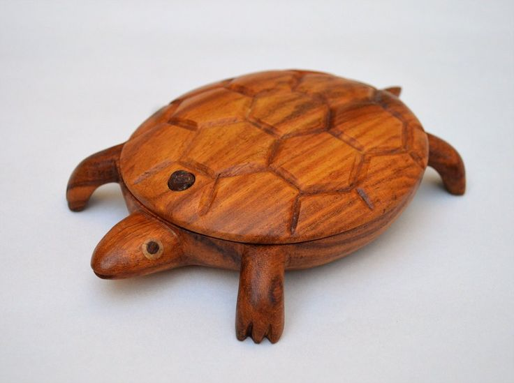 Handmade turtle jewelry box: Hand-carved jewelry/stash box is sculpted as a turtle with all the beautiful details.The box is a stash box, jewelry box, ring box, ring dish, shelf display and a toy. Size from outside approximately: Length: 18 cm, Height: 3 cm. Material: 100% from tropical Hard Tali wood (No rain forest was harmed). Method: Hand-turning, Hand-carving.