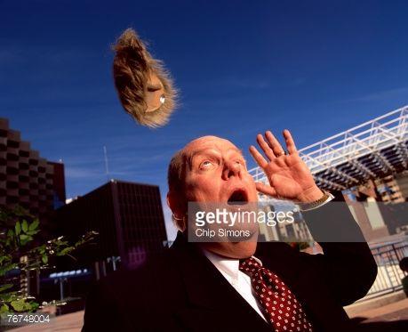 Stock Photo : Man losing wig