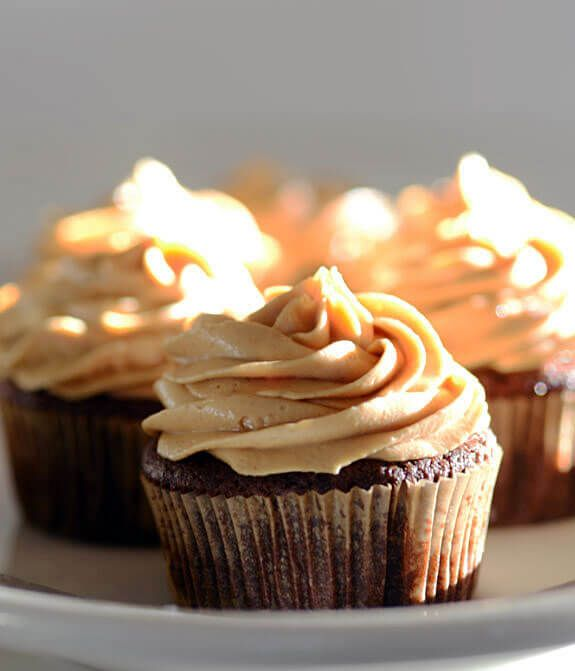 Peanut Butter Frosting made with only 5 ingredients --peanut butter, palm shortening, honey, vanilla stevia, and salt. Make it paleo with sunflower butter!