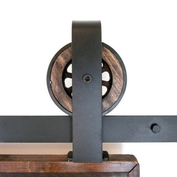 This is a BEAUTIFUL rustic industrial steel top mount sliding barn door hardware set. Made in the USA by hand from high quality rugged buffed steel and wood. This beautiful set of hardware takes you back to the industrial time, all within your own home  Includes:  (1) Track (2) Rollers - 5 1/2 Diameter, 1 1/2 Deep (4-6) Wall Spacers (2) Door Stops (1) Floor Guide  To be used with opening sizes 3-4. Measures approximately 9 1/2 from the bottom of the track to the top of the bracket. Max door…