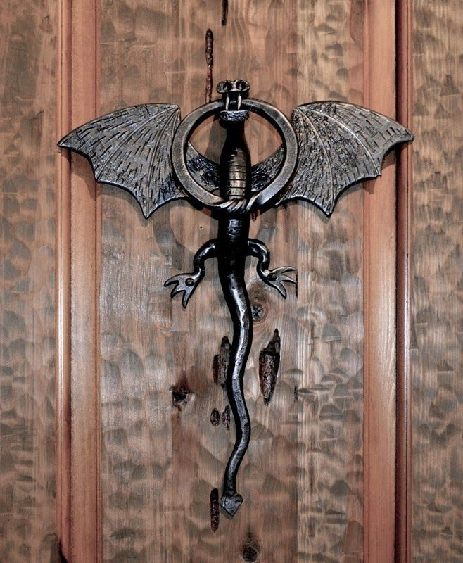"""Photo: Dragon Door Knocker on a Castle Door - Medieval Castle - by Scottsdale Art Factory  Castle door design - 5"""" thick - hand forged with wrought iron hardware. Castle doors are the original security doors. Solid American Cedar Cypress (not kiln force dried) (renewable resource timber). Designed from the historic record, these doors are hand hewn, they are mortise and tenon Joined (means master hand crafted - not fast process glue up and press), and all species of wood are available…"""