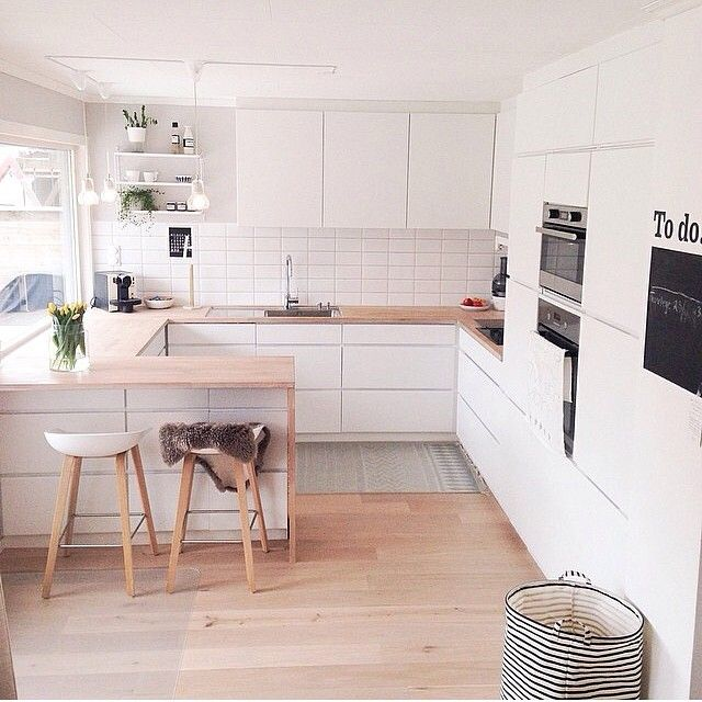 White kitchen with wooden floors