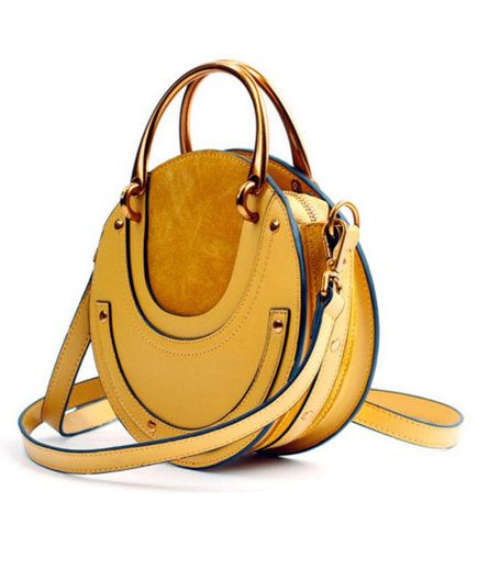 691df8f87c36 6 Stylish Crossbody Bags That Go With Absolutely Everything | This beauty's  unique shape, striking gold hardware, and contrasting cowhide and suede  leather ...
