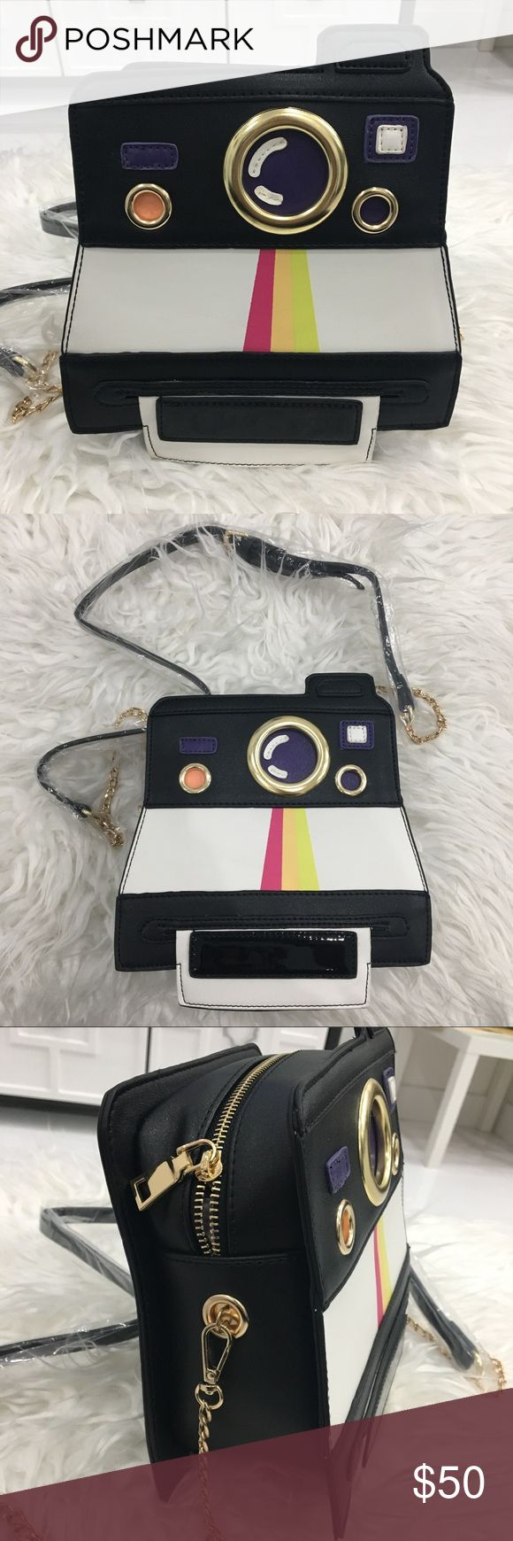 Polaroid camera cross body bag Cross body bag in the shape of a Polaroid camera. Bag has gold zippers, chain and accents. Very cool and unique and great quality!! Water bottle is there for size. Bags Crossbody Bags