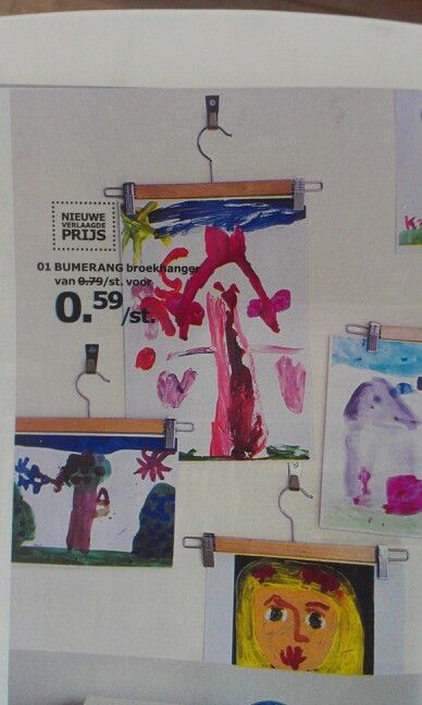 Geweldig idee uit de nieuwe ikea gids! Een kledinghanger gebruiken als ophangsysteem voor tekeningen...