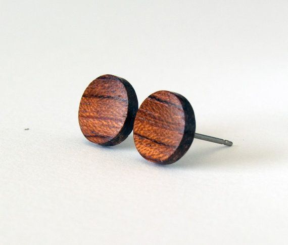 These flat, wood, stud earrings are handmade from beautiful bubinga hardwood. My husband (an accomplished woodworker) cuts them out and I sand them