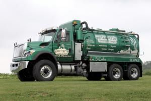 January 2012- Owners Rene and Jessica Goulet added this all-metallic green 2012 International WorkStar with 4,000-gallon steel tank and Wallenstein 1054 (Elmira Machine Industries Inc.) dual-cooled pump from Vacutrux Limited to their fleet. The truck features a 30-ton four-stage hydraulic dump system, a high-level pump exhaust with inline muffler directed to the diesel stack, stainless steel toolboxes and hose trays, a Giant 2,500 psi pressure washer & 100-gallon stainless steel freshwater…