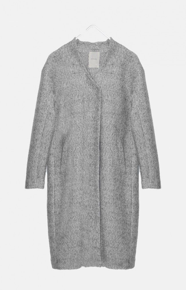 CELINE from Nümph is an oversized and loose-cut coat constructed from a wool blend fabric featuring a concealed button placket and a dropped shoulder cut and a slightly raised collar stand.