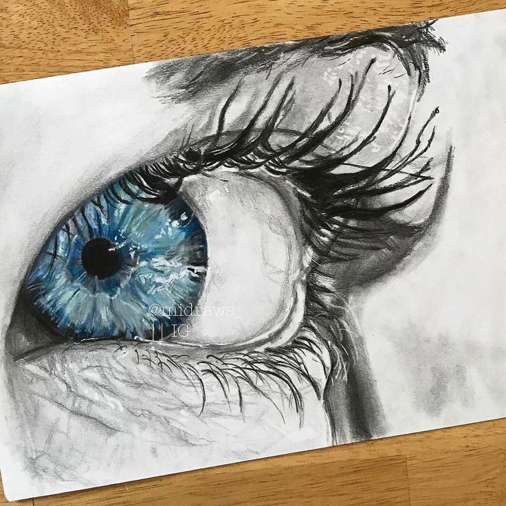 Sabria Phillips- The artist makes the focal point the blue iris of the eye by using an achromatic color scheme