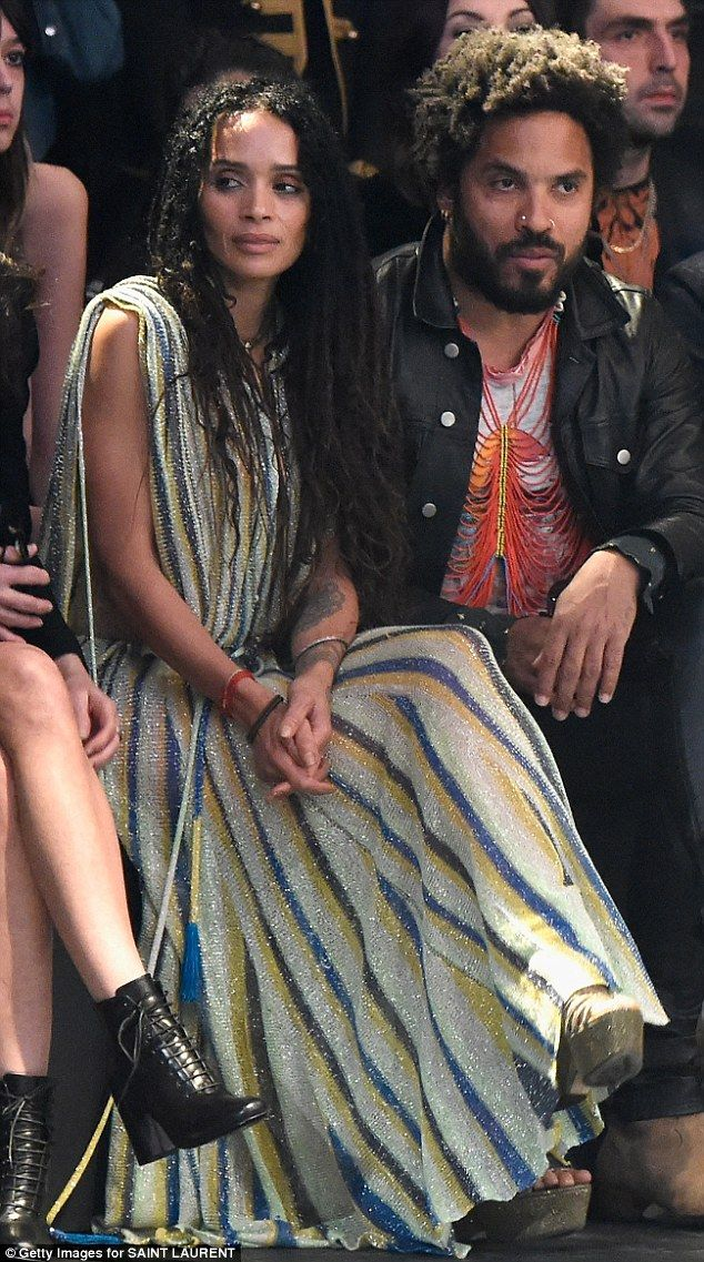 Still best of friends!Lisa and her ex-husband Lenny sit front row at the fashion show; they divorced in 1993