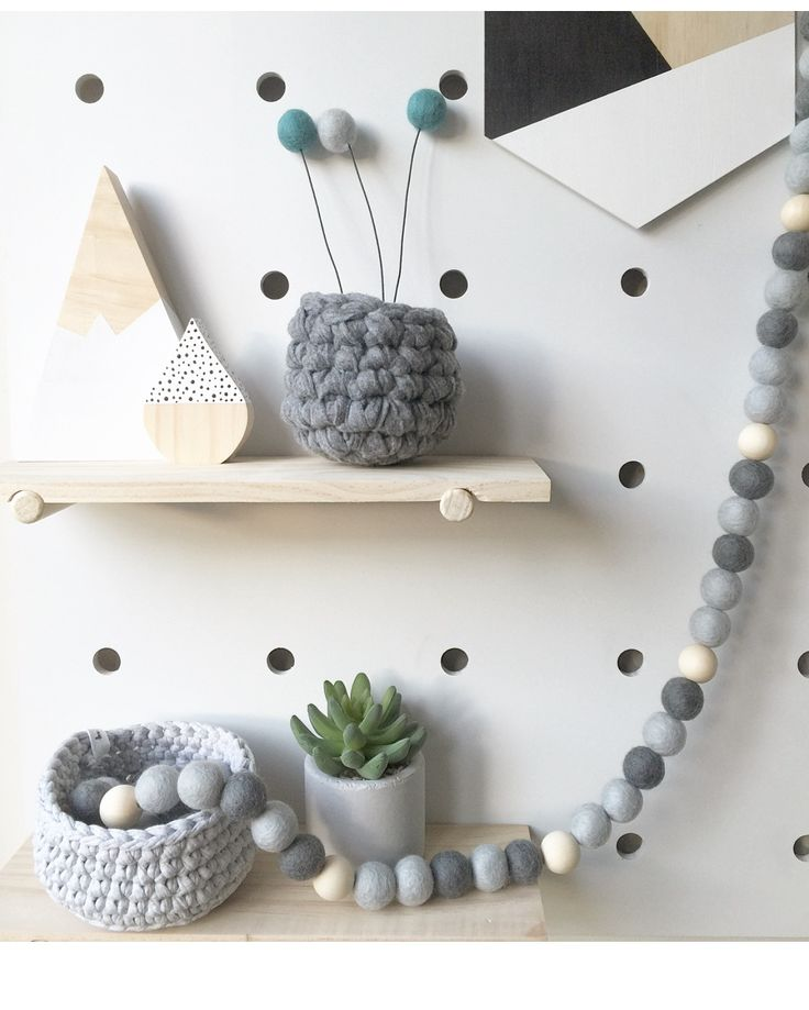 Beautifully Boho or Scandi Eco friendly NZ Wool and natural wooden bead garland. The perfect gender neutral Nursery and room accessory