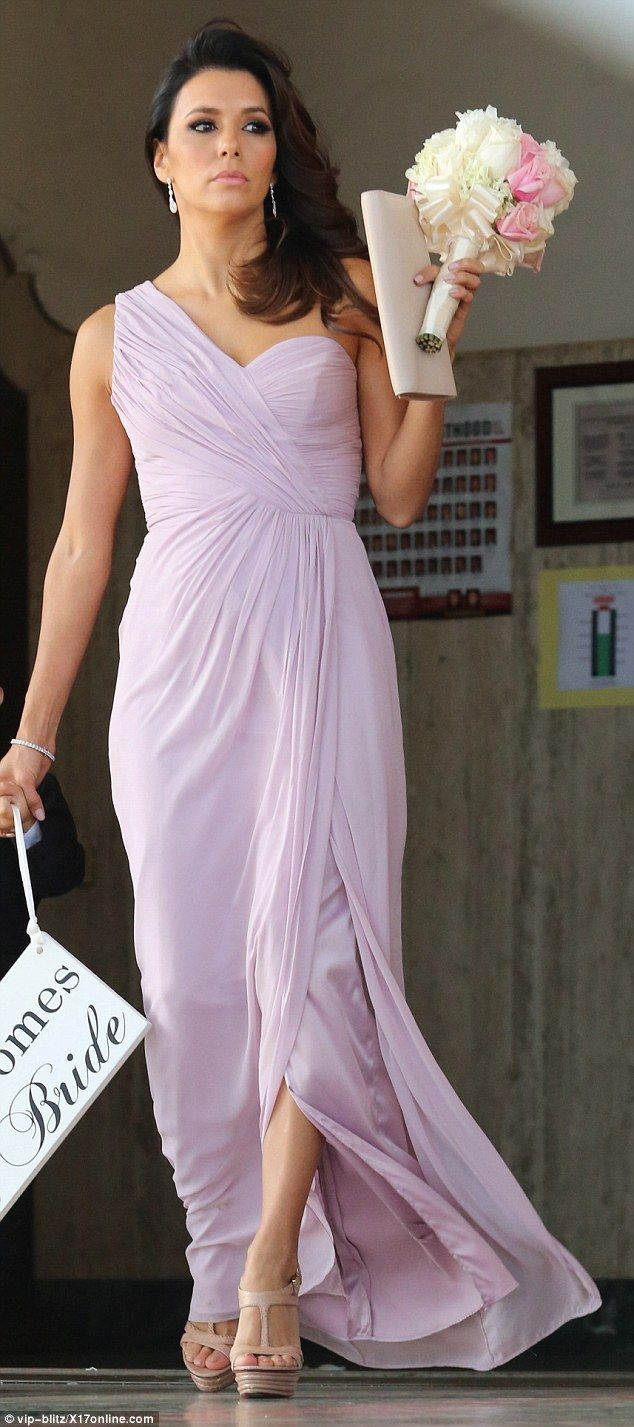 Eva Longaria stepped outin a lilac asymmetric gathered gown for the wedding of a friend i...