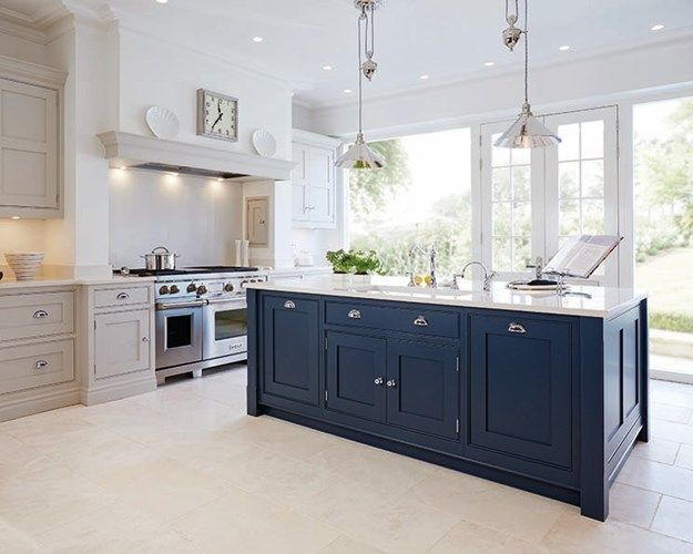 So this is the 'feel' that I love. Pale floor, pale mushroom cabinets...but only half height....lots of light from the garden..., dark blue island....