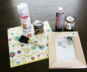 Decoupage Frame  Unfinished wood frame  Spray adhesive  Scrapbook paper  Foam brush  Paint or water-based stain  Scissors  X-acto knife (razor blade cutting tool)