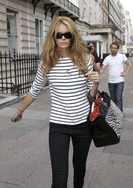 Elle Macpherson.  Classic striped to p, black pants and statement bag.  Subtle pattern mixing.