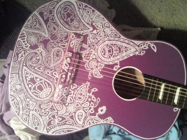 "You can paint or spray a guitar or apply woodcutting techniques but you can also simply use Sharpie permanent markers. They call it ""Sharpie a guitar"". Now this has been and still is popular among certain creative minds. You can find videos on You Tube called ""How to Sharpie a guitar""."