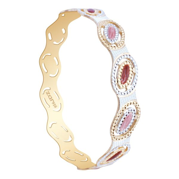 Lovely sleek gold bangle with beads and diamonds.