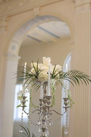 Candelabra Centerpiece With Flowers and Palm Fronds
