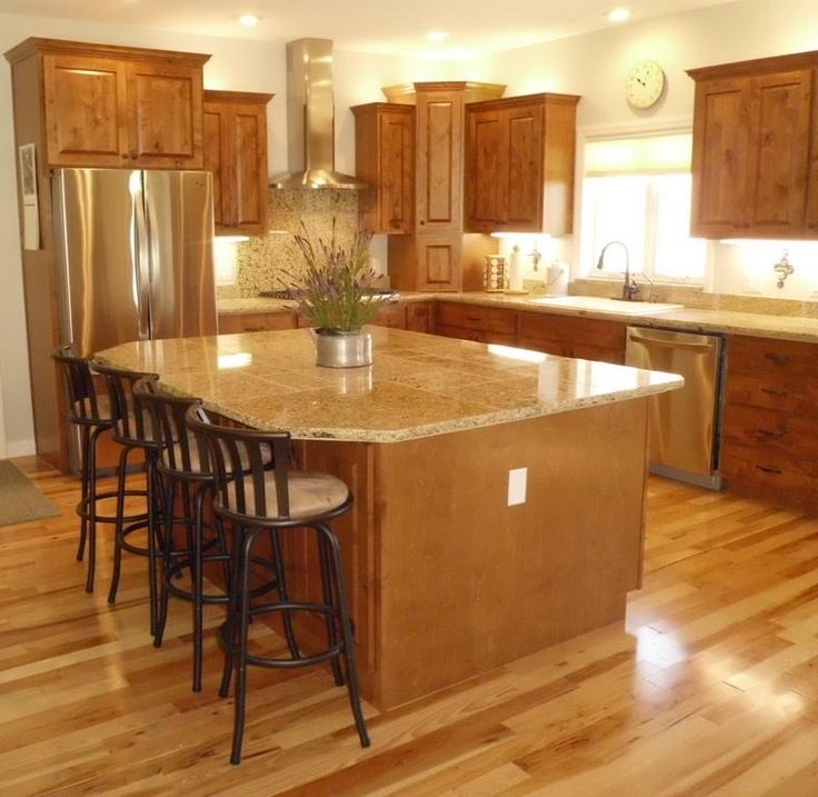 New construction knotty alder cabinets with medium brown for Kitchen center island cabinets