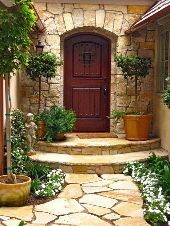 entry with stonework and curved steps