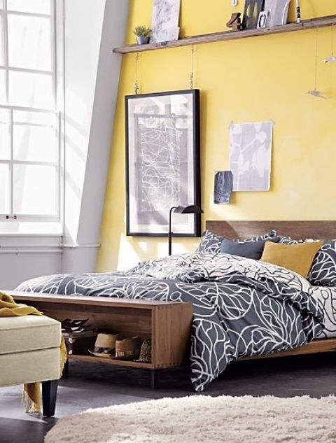 Blue comforter with yellow walls                              …