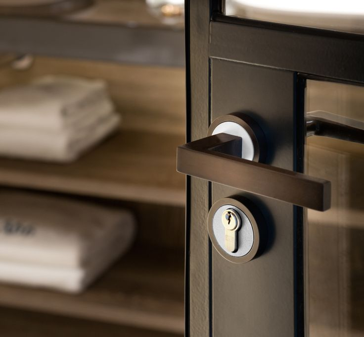 Krolle Lever Handle with matching cylinder escutcheon.