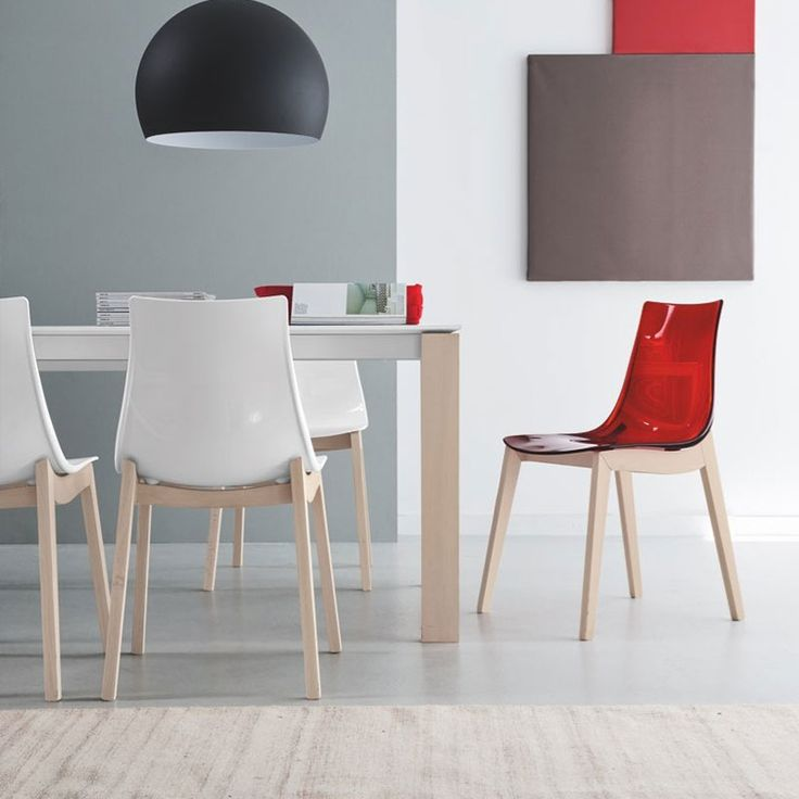 Led W Chair by Connubia Calligaris. The wooden legs come in a range of finishes and are teamed with contemporary transparent seat colours.