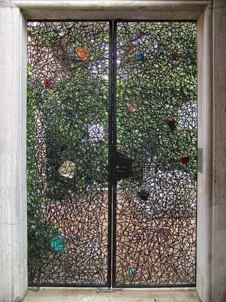 Venice Guggenheim: black steel wired gate containing big Murano glass stones