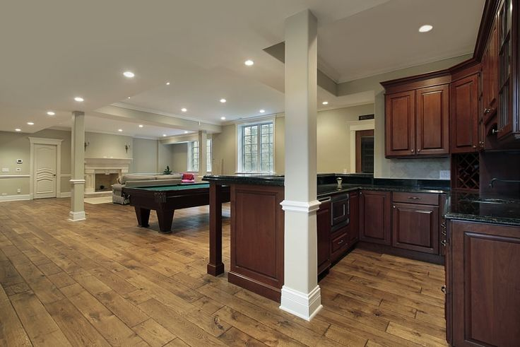 Expansive Open Plan Basement Area With Fireplace