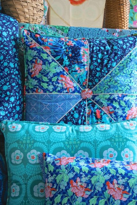 Amy Butler's Violette Fabrics. Pieced pillow at back.                                                                                                                                                     More