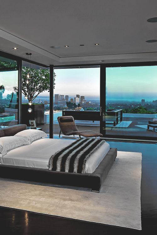 Bedroom Interior Design with a view of Pool