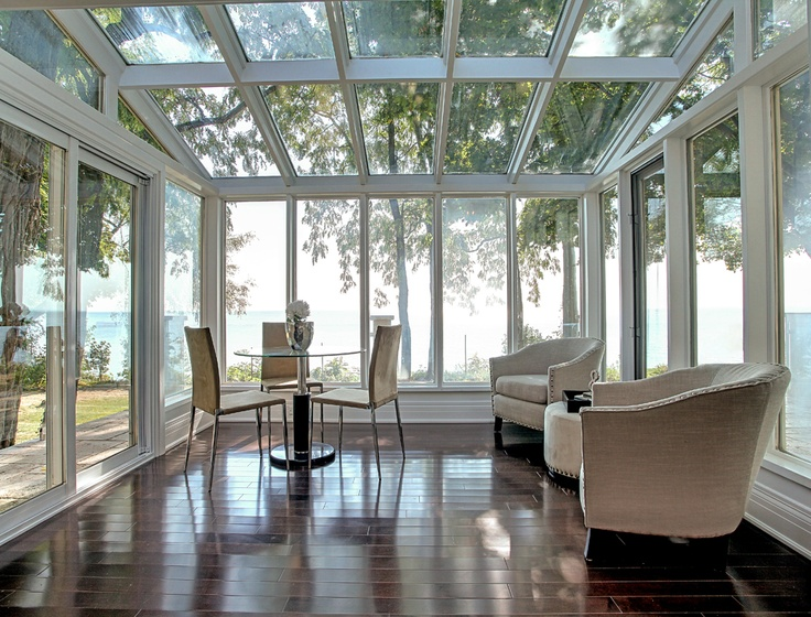 Savor the lakefront serenity in this beautiful sunroom