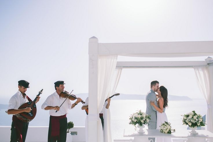 celebrating the first kiss like husband and wife! #wedding #planner #diamond #rock #bride #groom #ceremony #santorini #cyclades #traditional #musicians