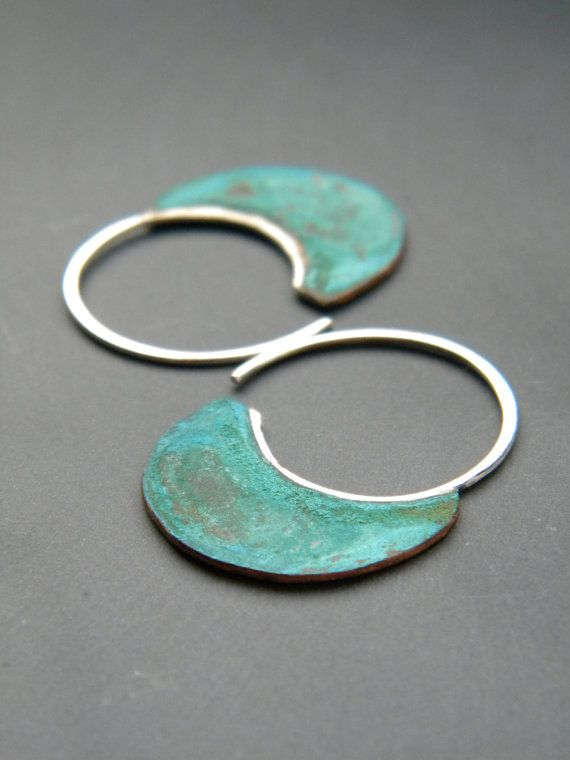 handmade copper and sterling silver earrings ( Etsy:: http://www.etsy.com/listing/82331747/little-urban-hoops-verdigris-handmade  )