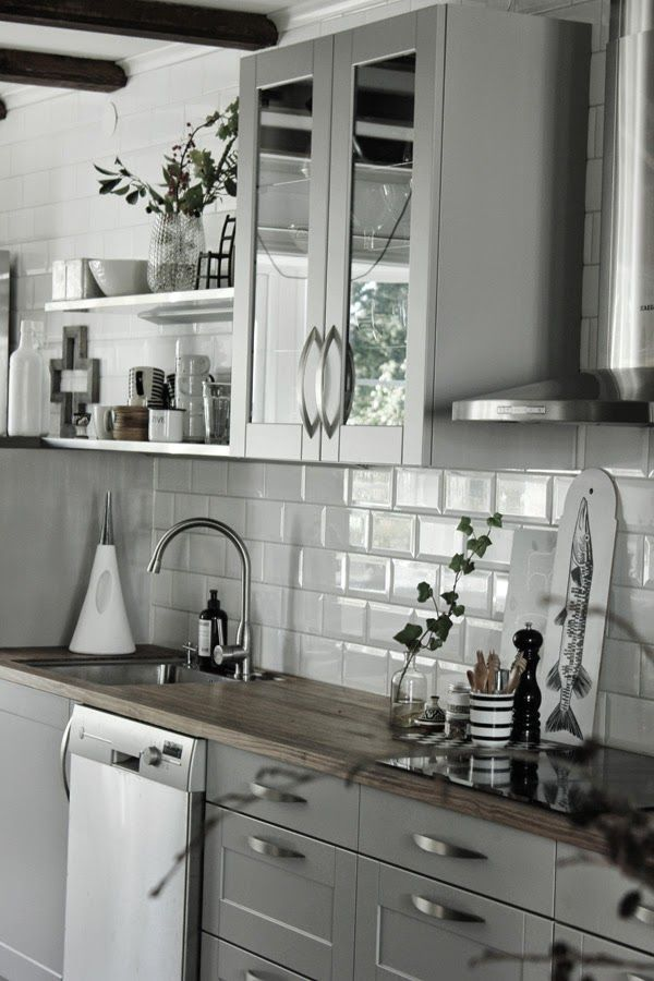 white subway tiles with grey cabinets