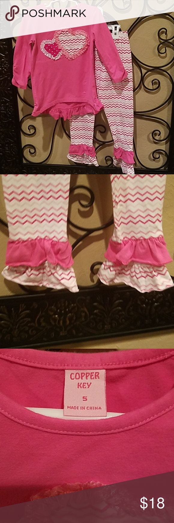 Girls cute pink/white chevron pants set. Heart on shirt and ruffle bottoms on pants. Great condition, only worn 2 times. Copper Key Matching Sets