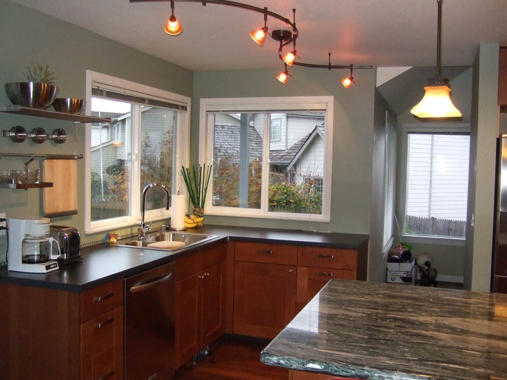 medium brown IKEA cabinets with black and gray granite countertops ...
