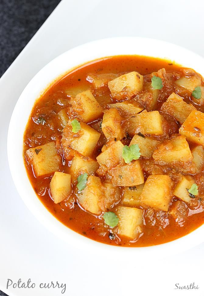 Potato curry or aloo curry recipe with step by step photos. Simple and easy to make. Can be served with rice, bread, pav, chapathi or roti
