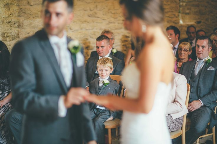 Proud son watching his dad tie the knot