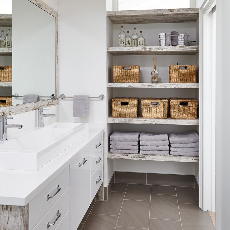 Delightful little bathroom donning the famous Miralis synthetic Rough Chic and similacquer white gloss. This room is very inviting with its delicate tones, subtle vintage touch and a hint of rustic charm. Evocative of the gentle morning light. By : BIGLAR KINYAN DESIGN