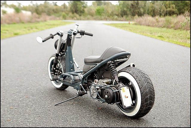 """Honda Ruckus Cafe Risque Custom Honda Ruckus """"Cafe Risque"""" by composimo a custom Scooter building garage. This custom Honda Ruckus is inspired by cafe racer. Honda Ruckus Cafe Risque features Custom Honda Ruckus tank, Custom Honda Ruckus seat, Custom Clip on handle bars Honda Ruckus Custom exhaust, Honda Ruckus frame modified, Bar end mirrors, Honda Ruckus Cafe Risque looks extremely unique. composimo has done an art work with this Ruckus."""
