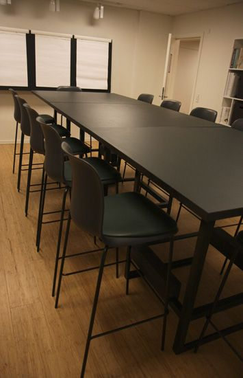 Conference table with barstools and flipoverwall