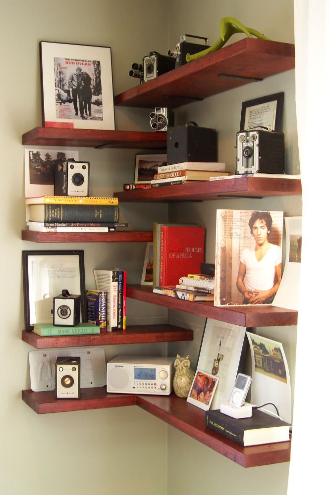 "I don't necessarily like the staggered shelves, but like the way they are attached to the wall - L brackets hung the opposite way as usual - with the ""wall"" portion pointing up rather than down"