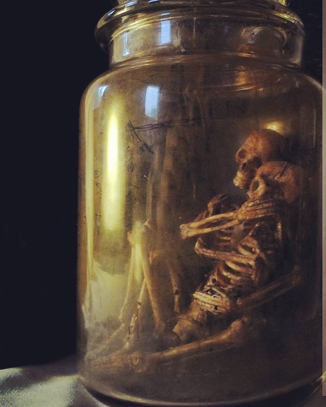 Pin for Later: 21 Dollar Store Finds That Put Your Expensive Halloween Decorations to Shame Jar of Skeletons