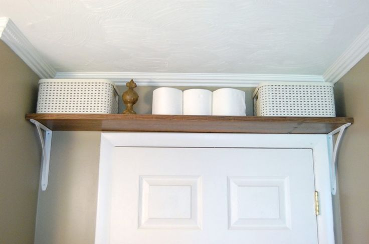 No room in your bathroom for storage? Add a shelf above the door for more space.