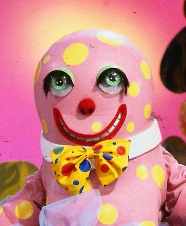 Mr Blobby....creepy looking! I got told he was banned for doing something bad like swearing and going mad on TV or something! It always seemed a bit sinister...