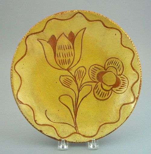 "Pennsylvania sgraffito redware plate, 19th c., with floral decoration, 9 3/4"" dia."