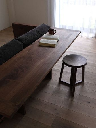 Consider a fold-out table attached to the back of your couch.  This is a great idea for small living or apartment life.